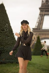 Sarah Loven walking at Eiffel Tower.
